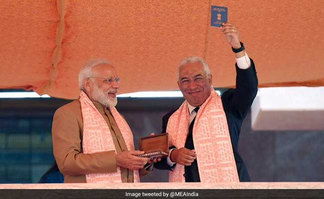 Portugal's PM Antonio Costa displays his OCI card at PBD Convention in Bengaluru, Jan 2017